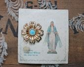 vintage enamel Virgin Mary pin on card