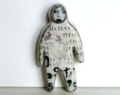 small porcelain figure with underglaze drawing and overglaze decals