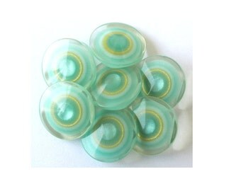 6 Plastic buttons , new buttons, blue green with yellow circles cover with translucent plastic 22mm