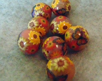 foiled, round polymer clay beads with flowers and butterly