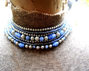 Boho vintage 60s , seven strands choker necklace with a different size and shape pearl beads ans pastel blue glass beads. Made in Japan.