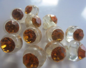 Vintage buttons, lot of 12 matching, clear acrylic with amber/ citrine rhinestone solitaire centers (aug 86 )