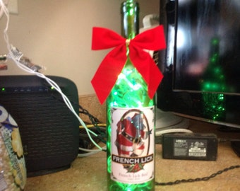 Beautiful  lighted wine bottle with Santa Claus on front!