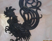 A Black Metal Rooster Wall Art