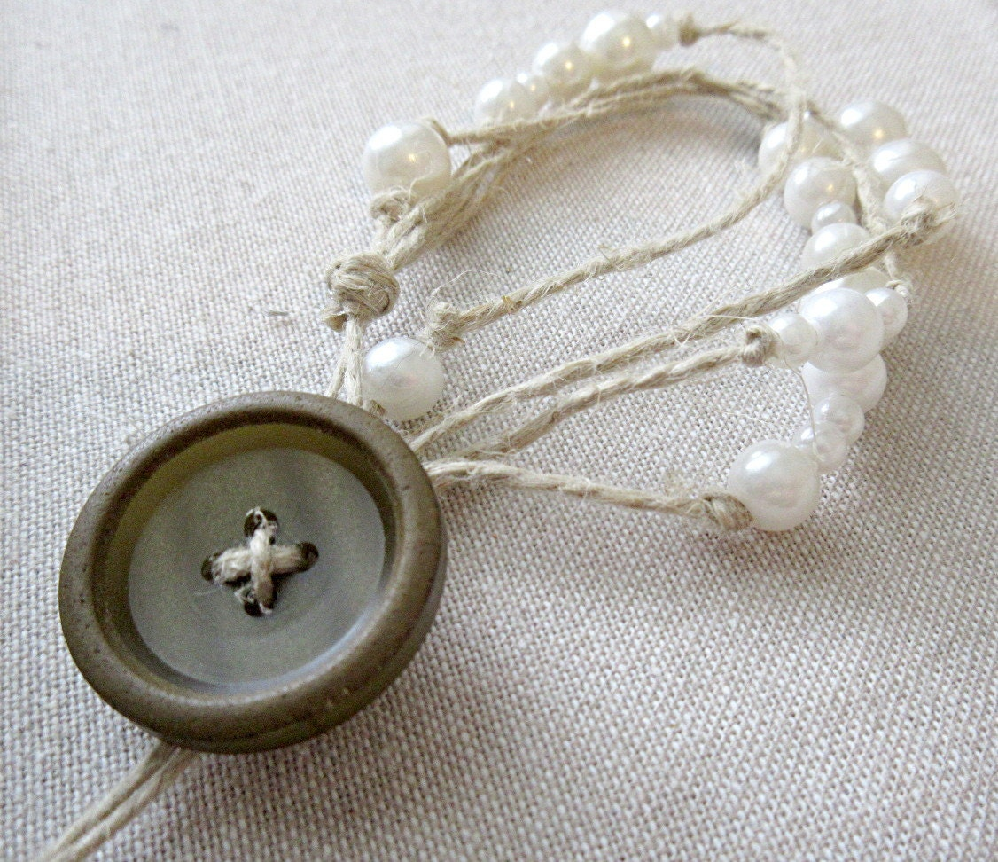 Math jewelry: multistrand pi bracelet in hemp and faux pearls with a button toggle closure.
