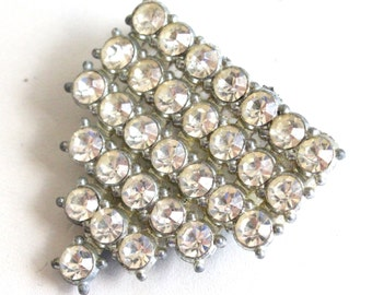 Vintage silver tone metal lapel pin with white rhinestones