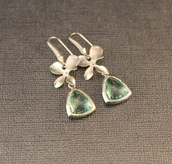 The Alexa Orchid Blossom and Erinite Blue GreenTrillion Matte Silver Plate Earrings with Crystal Inlaid Earwires