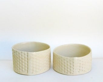 a pair of hand built porcelain bowls  ...   2 modern low bowls   …  dot matte bowl