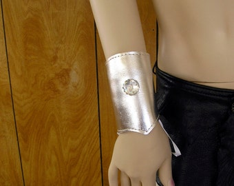 """Metallic silver lace-up leather cuff with glass swirl orb, grommets and ribbon ties, 8 1/2"""" around, 4 1/2"""" wide"""