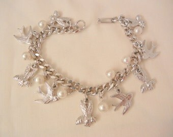 Let me tell ya bout the birds n the bee's charm Bracelet