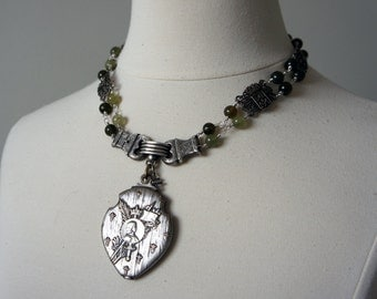Antique Assemblage Necklace with Joan of Arc Mirror Locket Green Garnets and Souvenir Bracelet Links