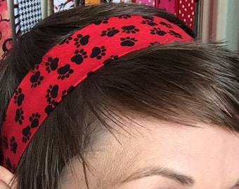 Black Puppy Dog Paws On A Red Stay Put Headband
