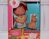 Vintage Strawberry Shortcake Cafe Ole' doll and Burrito pet - In original box never taken out of the box - all original pieces included