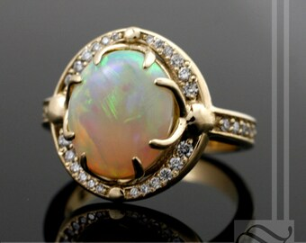Australian Opal Halo ring with Diamonds in 14k yellow gold
