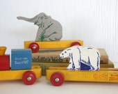 Wooden toy train by StromBecKer. Cars, locomotive, animals, zoo, elephant, polar bear, primary colors, blue, yellow, red