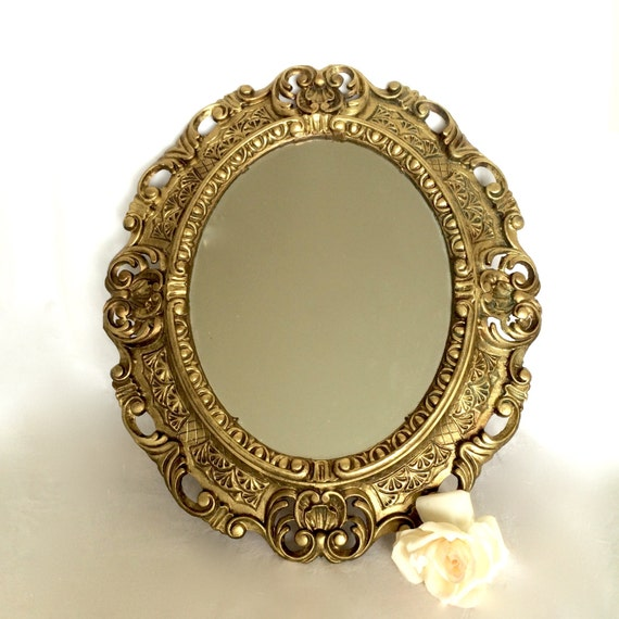 Ornate oval gold mirror hollywood regency by ellasatticvintage for Plastic baroque mirror