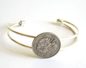Japan coin cuff bracelet . coin bracelet . world coin jewelry . adjustable cuff . Japanese flower . silver coin bracelet . floral bracelet