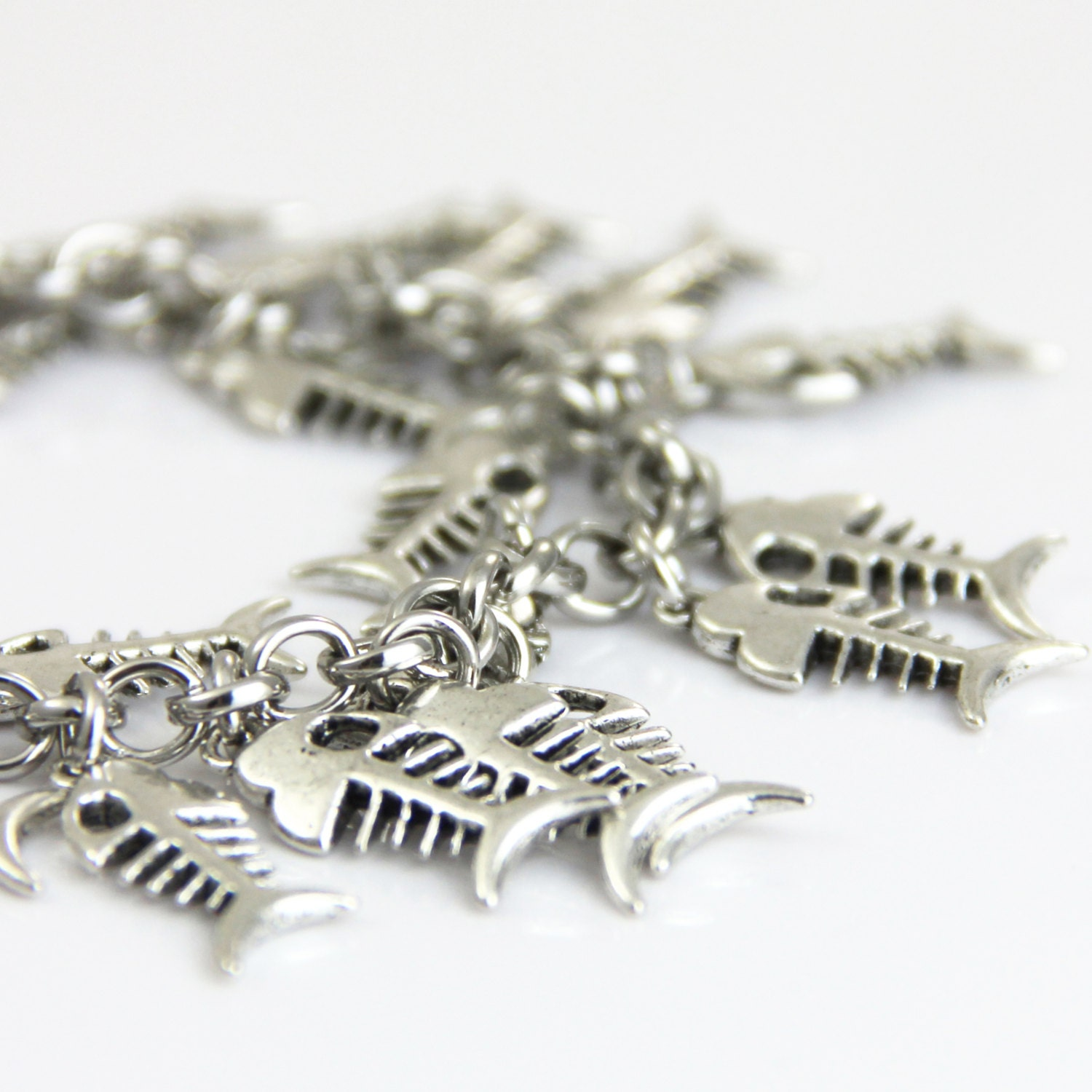 History of Fish Tales Silver Fish Bone Charm Silver Cluster