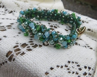 Handwoven Beaded Tennis Style Bracelet in Greens Sparkly with a Button Clasp