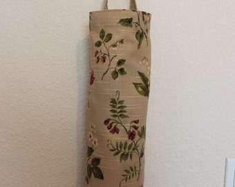 Plastic grocery bag holder, bag holder, floral pattern.
