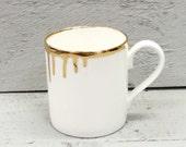 Gold drip bone china mug.