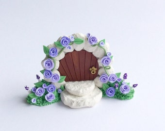Fairy door gate with lilac coloured roses handmade from polymer clay