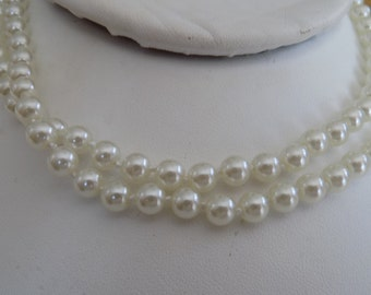 Vintage necklace, 31 inch 7 mm. individually knotted satiny white faux pearl necklace
