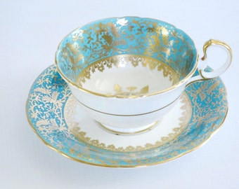 Vintage Aynsley Tea Cup and Saucer Set Turquoise w Gold Snowflake Medallion  /  Vintage Teacup & Saucer Teal heavy Gold Gilt by Aynsley