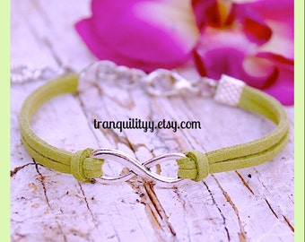 Infinity Bracelet , Faux Suede  Adjustable Charm Bracelet Handmade By: Tranquilityy