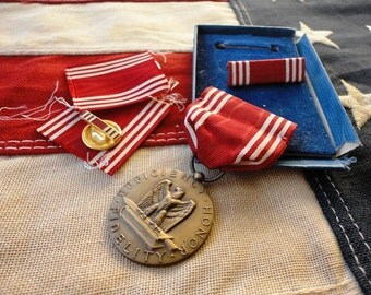 WWII-era Good Conduct Medal in Box