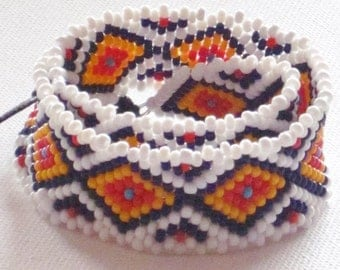 PRICE REDUCED Native american  bead weaving double wrap bracelet in navy blue, marigold, red, turquoise and white
