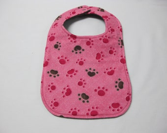 Paw print toddler bib in pink and brown