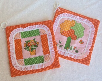 Orange pot holders/ vintage set of two pot holders/ orange polka dot with white eyelet lace/ flowers and trees pot holders