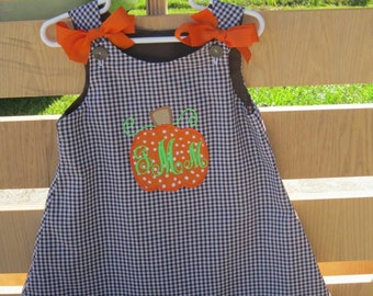 Pumpkin outfits on brown gingham fabric!