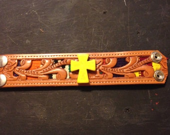 Leather cuff bracelet with yellow cross accent