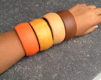 Leather bangles earth colors, orange, mosterd, cream and dark brown
