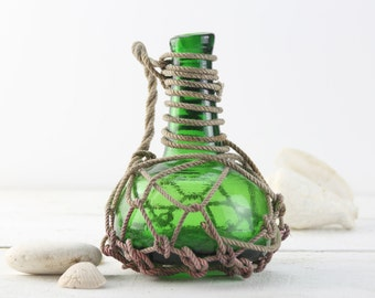 Beach Decor, Green, Pirates Rum Jug,  Glass  in Rope Netting by SEASTYLE