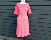 pink dress . crochet and knit sweater . vintage 60s .  bright bell sleeve . madmen