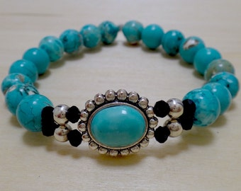 White and Blue-Green Beaded Bracelet with Circular Silver and Turquoise Charm