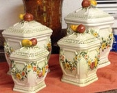 LEFTON Canister Set four embossed fruit in excellent condition  Mediterranean  appeal storage kitchen decor