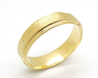 Gold wedding ring textured and hammered