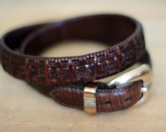 vintage brown leather belt with silver buckle