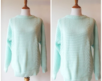 Women's light blue knit sweater