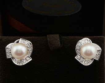 Sophisticate Damiani Mikawa 9 mm. Japanese pearl and .90 Ct diamond earrings