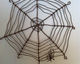 Barbed wire spider web