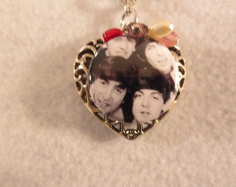 The Beatles faces up close heart necklace