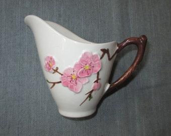 Metlox Poppytrail PEACH BLOSSOM Creamer, Embossed Pink Flowers, Twig Handle, ca. 1950