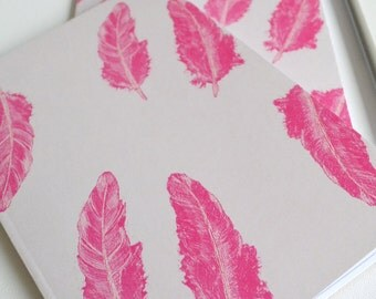 Blow Me Down, A5 Lined Feather Pattern Notebook, Recycled paper A5 Notebook with a pink feather design