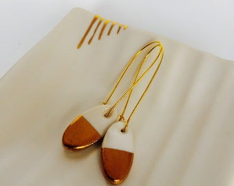 Porcelain earrings with gold lustre.