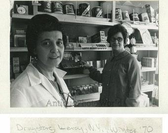 Women pharmacist in drugstore Leroy New York vintage art photo